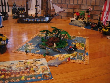 The Pirate's Cove board game can be played using Pirate LEGO ships and islands